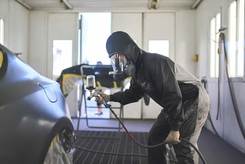 huntington beach auto repair - man painting a car