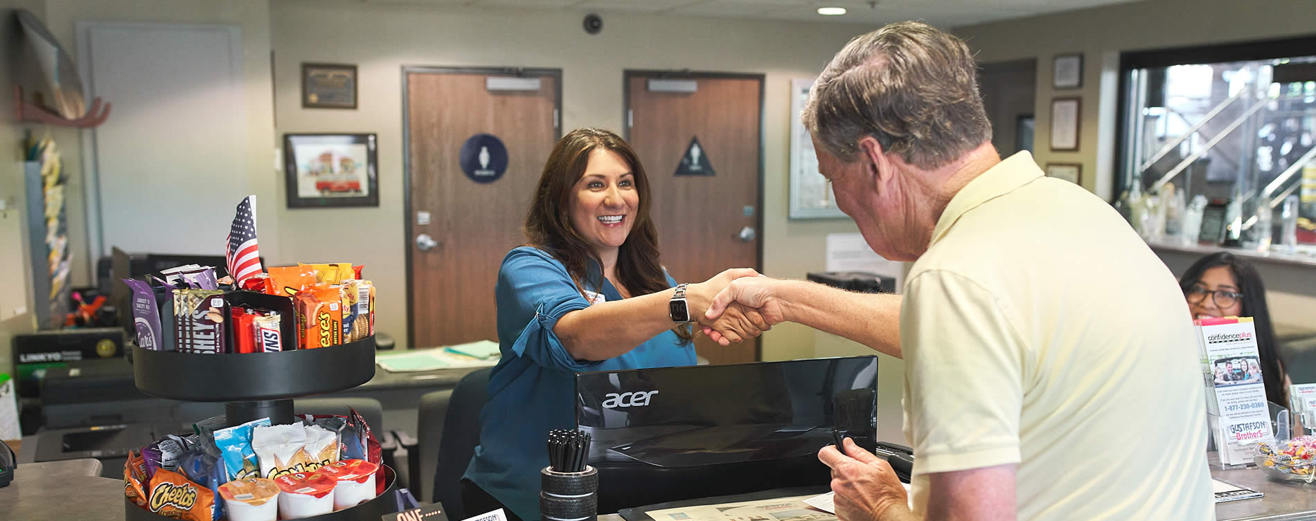 huntington beach auto repair shop with happy customer at front desk