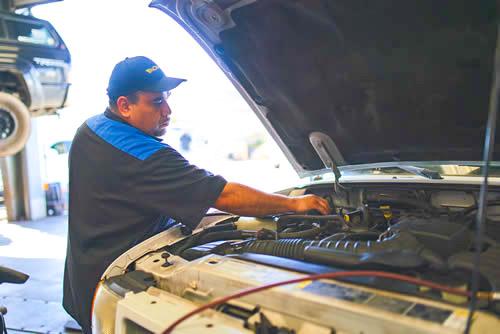 huntington beach auto repair - man working on a car